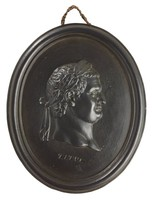 Oval medallion of black basalt with the bas relief portrait bust of Roman Emperor Titus (39-81 AD) facing right, wearing laurel leaf crown, the name TITUS is impressed below the truncation, self frame, pierced to hang.