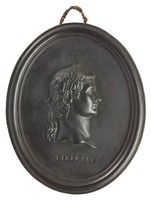 Oval medallion of black basalt with bas relief portrait bust of Roman Emperor Tiberius (42 BC-37 AD) facing right, wearing laurel leaf crown, the name TIBERIUS impressed below the truncation, self frame, pierced to hang.