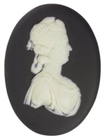 Portrait medallion in white jasper with black jasper dip on the front only and white relief depicting Dorothea, Lady Banks (1758-1828), wife of Sir Joseph Banks, to right, wearing a draped garment, her hair in rolls and tied with a wide hairband.