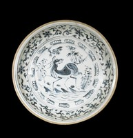 Glazed stoneware dish with a deer by a river with pine, bamboo and orchid plants surrounded by a band of scalloped lotus petals, chrysanthemums and lappets on the exterior, all painted in underglaze cobalt blue oxide