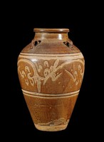 Jar with rolled rim and four strap handles and carved floral design