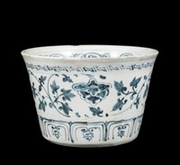Bowl with scrolling peonies, a square spiral scrolling pattern above and lappets below, all painted in underglaze cobalt blue oxide.