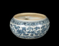 Bowl with underglaze blue decoration of floral scroll enclosed by petal motifs