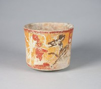 An important bowl from the Peten area; has scene from underworld; principle figure is deer in black and white; two seated figures; above the deer is a red tab containing two vertical glyphs.  there is a red and black rim band and a similar basal band.  Figures painted in red outlined in black; all on orange ground.