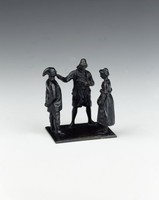 Group of three figures.