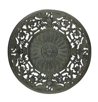 Cast iron plate with a wide, pierced outer border of scrolling foliage and swans, the well with a central sunflower surrounded by larger petal-like motifs