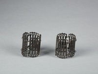 Pair of cast-iron bracelets, or cuffs, each comprised of five links in the form of pierced Gothic tracery.