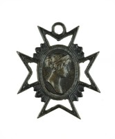 Small cast-iron cross pendant in the shape of a Maltese cross, the central medallion with the portrait bust of Queen Luise of Prussia (1776-1810) right in a silver mount.