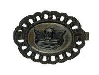 Cast-iron clasp, probably for a necklace, the border pierced with beading, in the middle an oval medallion with a cherub adapted from Raphael's Sistine Madonna, on a polished steel plate.