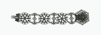 Delicate cast-iron bracelet made of three large circular links with pierced motifs of acanthus leaves and a central rosette between three smaller links of pierced foliage with a central floral element; the clasp a large, pierced, and layered floral element.