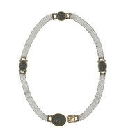 Cast-iron necklace comprised of a mesh chain with three small oval medallions set in gold, the clasp a larger oval medallion set in gold, all with antique reliefs.