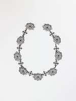 Cast-iron necklace with nine large links in the form of pierced rosettes and eight smaller links in the form of four adjoined fleurs de lis, the clasp is missing.