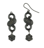 Pair of cast-iron earrings, each of S-scroll form with a central floral element and a shell-shaped bauble hanging below, with extended earwires, one missing.