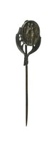 Small cast-iron stick pin, the finial in the form of a central oval medallion supported by two palm fronds, the medallion with the image of Cupid and Psyche.