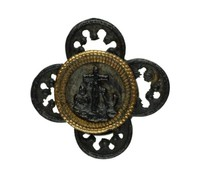 Small cast-iron cuff link, or button, comprised of four Gothic tracery elements and a central medallion with the symbols of faith, love and hope—a cross, heart and anchor—on a polished steel plate and set in gold.