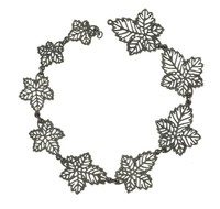 Cast-iron necklace fragment comprised of nine links of graduated sizes in the form of pierced grape leaves.