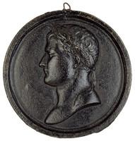Laureate bust in profile left.