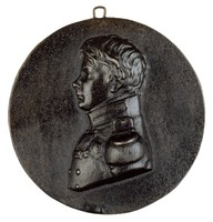 Bust in profile left in the uniform of the Prussian First Infantry Regiment with the Order of the Black Eagle, the Iron Cross, the War Memorial Medal 1813-15, and the Russian St. George's Cross.
