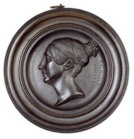 Head in profile left in cast-iron frame. Born princess of Saxony-Hildburghausen, in 1810 married King Ludwig I of Bavaria.