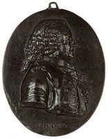 Cast iron portrait medallion modeled in high relief with the image of the Swedish botanist Carolus Linnaeus (Carl von Linné; 1707-78) in profile right in civilian dress with a sprig of Linnaeus borealis, or twinflower, in his buttonhole and wearing the Order of the Polar Star, a Swedish order of chivalry, below the portrait is the name LINNÆUS, at the top is a hook to hang.