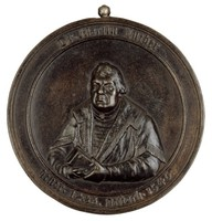 Obverse: Bust front, holding the Bible. Reverse: Luther with his Ninety-Five Theses at the door of the All Saints Church in Wittenberg.