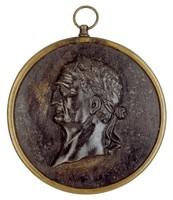 Laureate head in profile left, in brass frame.
