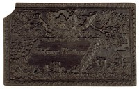 """Calling card inscribed with the name """"Professor Plattner"""" on small tablet set in landscape with view of foundry buildings, below crossed hammer and gad."""