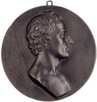 Portrait bust of the poet and historian Friedrich von Schiller in profile right.