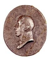 Bust in profile left in Prussian general's uniform.