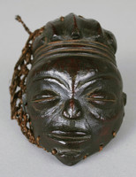 Miniature Lunda Complex mask in the form of the Chokive beautiful maiden type, but lacks the characteristic star incised on the forehead