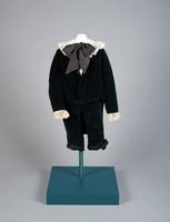 Boy's suit; two piece dark green velvet suit, seven waist buttons. Legs trimmed in black silk, ecru machine lace cuffs. One hip pocket and button fly.