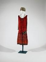 Burnt orange, sleeveless, embroidered hem, large gold flower, silk lined
