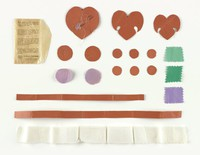 Sample cloth kit for color recommendations, paper templates for hearts and lines, and sewing needles used by Florence Gilbert Day to produce the Grapevine Quilt (1987.95.1).