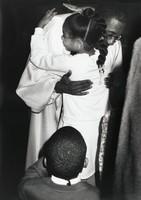 Rev. William H. Greason Embracing Young Parishioner, Gordon Parks, silver print
