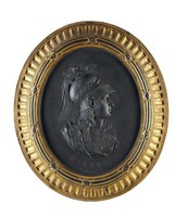 Oval, self-framed black basalt medallion with the portrait of the goddess Minerva, probably after Montfaucon, in full armor in profile right, below her the name MINERVA, the frame gilded with an inner border of reeds bound by a series of crossed straps, the outer frame of fluted cavetto moulding
