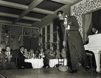 Nat King Cole Performs at Ciro's Night Club in the Audience Sit Jack Palance (left) and Gig Young (right), Sid Avery, gelatin silver print