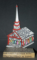 Plywood cut out of a church painted with figures and text on wood base.