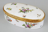 Large porcelain snuffbox and cover, oval and painted all around the exterior with sprays and sprigs of flowers, the interior of the cover rim with a family scene in a landscape, the rim and cover rim with a contemporary hinged copper-gilt mount.