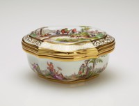 Small porcelain snuff box with gilt metal mounts, cartouche-shaped and painted around the exterior sides with figures in a continuous landscape and on the top of the lid with scenes of men on horseback in landscapes, the lid with an additional gilt shell-and-scroll border, the underside painted with a scene of ladies and gentlemen by a fountain, the interior lid decorated with the scene of an amorous couple in a landscape with servant, with gilt metal mounts.