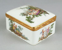 """Porcelain snuffbox, mounted in gold, rectangular and painted on each side of the exterior and the cover with a colorful mythological vignette, the cover interior painted in sepia and flesh tones with """"Leda and the Swan"""", the rim and cover rim with a wave-engraved hinged red-gold mount."""