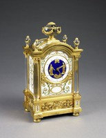 Louis XVI mantel clock set with six plaques of soft-paste porcelain, each decorated with brightly colored enamels in imitation of jewels in a pattern of scrolls and foliage in green, turquoise, red, and gold on a white ground, the plaques fit into a plinth-shaped gilt-bronze frame flanked by four rock crystal Corinthian columns with gilt-bronze capitals and surmounted by draped urn finials, on top a large, central rock crystal classical urn draped with gilt-bronze garlands, the blue enamel clock face surrounded by a white enamel dial is mounted with two gilt-bronze classical figures with bells and mythological motifs, the base with scrolling foliage on four flattened bun feet