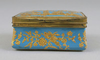 Enamel snuff box decorated with gilt Chinoiserie figures on a blue ground.