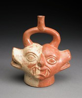 Stirrup-spout vessel with human animal faces. Includes two fanged humans (Ai-Apec) combines with two canine heads (sharing eyes) proper right if each human and proper left of each dog face overpainted with cream slip. Base slip is brownish-red