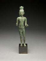 Tall slender figure of a male with a high headdress and a small figure of seated Buddha in center of headdress, hands held in a delicate pose (probably once holding a lotus stalk), hips slightly akimbo. Figure wears a skirt with a knotted belt in front. Eyes are picked out in silver.