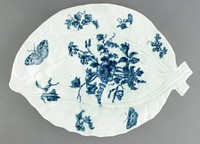 Blue and white, hand-painted, cabbage leaf shape with molded veins; flowers, fruit and butterflies, smeared blue transfer print