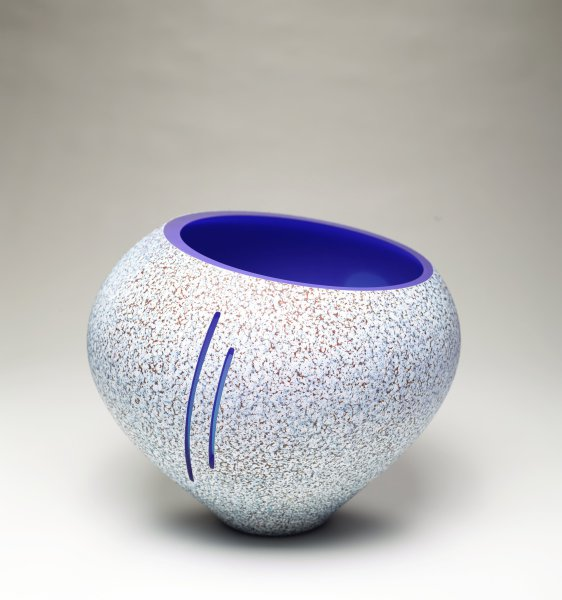 Blown glass vessel that was dusted with Kugler powder to create stone texture. Cuts made with a diamond saw.