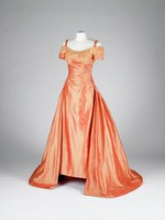 Full-length, off-the-shoulder ball gown of salmon-colored silk shantung with appliqué, faux pearls, sequins and diamanté on fitted, gathered bodice, full skirt with train, lined in orange silk