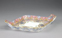 Lozenge-shaped, two-handled tray of soft-paste porcelain painted with overglaze enamel colors in shades of blue, yellow, lilac and green, the pierced sides decorated with an intricate pattern of ribbons and tulips, the center with geometric diaper motifs (four gilded star and dot pattern, four floral, diamond pattern) within gilt scrollwork and berried foliage borders on white ground, the reverse of the rim and handles heightened in blue