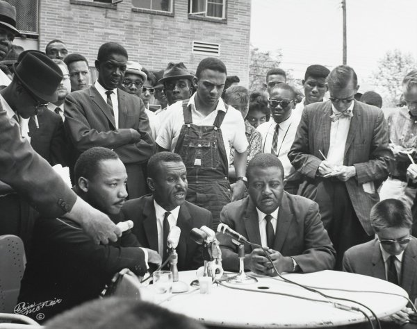 """Dr. Martin Luther King holding a press conference following his release from the Birmingham city jail, where he wrote """"Letter from the Birmingham Jail"""" on April 16, 1963, Chris McNair, gelatin silver print"""