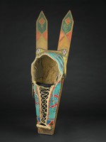 Full-sized Kiowa cradle; buffalo hide beaded in a background of turquoise with stylized floral and triangle designs in colors of red, white, dark green, cobalt, and greasy yellow. Inside of cradle lined in mattress ticking. Separate hide pieces attached at the top of cradle and beaded with two diamond designs of the same colors as the cradle is tacked down to the boards with red painted round brass buttons and hide dangles with metal cones. Cradle is attached to thick boards with upper half painted in blue, red, and yellow and brass tacks following the color designs.